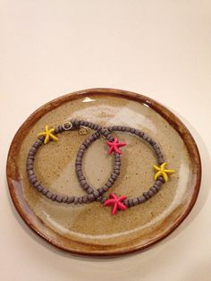 A personal favorite from my Etsy shop https://www.etsy.com/listing/230529598/yellow-pink-starfish-beaded-bracelet