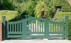 painted wood garden gates | Green-painted-wooden-asymmetric-driveway-gate-and-garden-gate.jpg