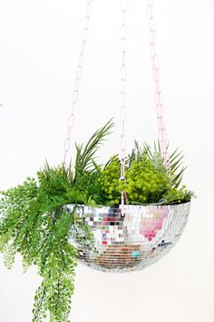 When a basket just won't do, make your own disco ball hanging planter.