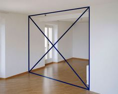 ...Swiss artist Felice Varini has been creating illusions of flat graphics superimposed on three dimensional spaces since 1979 using the same eye-deceiving technique called anamorphosis. The complete shapes can only be seen when viewed at certain angles, otherwise the viewer will only see some random broken pieces.