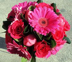 I would like the hot pink gerber daisy's with some white one's instead of roses.
