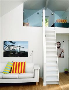 Teen kids loft playroom idea. What the hell is the picture in the back tho?