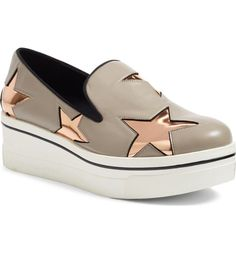 A metallic slip-on sneaker takes center stage with smooth contrast stars and a chunky platform sole for a standout look that takes its inspiration from '90s trends.