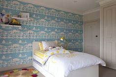 Bright and Bold Big Boy Room featuring Scandinavian-inspired wallpaper accent wall!