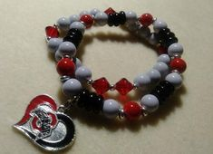 Two stretch bracelets with charm on one Stretch Bracelets, Beaded Bracelets, Football Bracelet, Handmade Items, Handmade Gifts, Hippie Boho, Charmed, Buckeyes, Trending Outfits