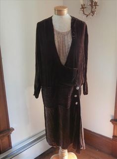 1920s brown silk velvet dress with crepe chiffon insert decorated with rhinestones, pave rhinestone buttons at hip, rows of pintucks, swag at left hip