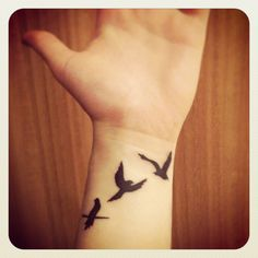 flying away bird tattoo