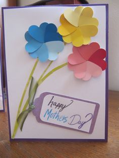 And this card i actually came up with by myself! I used paint swatches from walmart and a heart cutout my friend julianna bought me to make the flowers. I love the flowers but i really need to work on my hand writing!