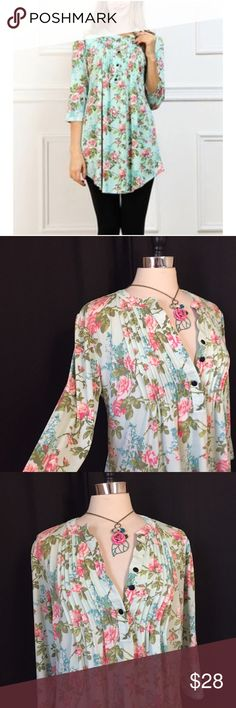 💗Reborn mint & pink rose notch neck tunic blouse Size medium. Button neck with pin tuck detailing. Asymmetric hem. Polyester, spandex. EUC  💟Fast 1-2 day shipping 💟Reasonable offers accepted 💟Purchase 3 or more items & get a special bundle rate!  💟Smoke-free home reborn Tops Tunics