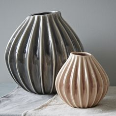 Beautiful organic concertina vases in stunning pink and smokey grey colourways. These would make a welcome addition to any home with it's simplistic yet unusual design. Perfect for a dining table, mantle piece or window sill.