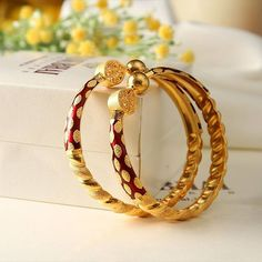 Versatility wrapped in red and gold! #Gold #Bangles #Ethnic #Red #Manubhai #Mumbai #Borivali