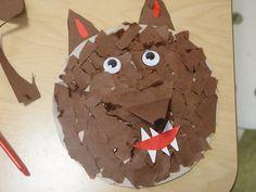 Knip uit karton een cirkel, daarna stukjes bruin papier scheuren, lijm op het karton en gescheurde stukjes opplakken. Dit zijn de haren van de wolf. Wiebeloogjes er op, oren uitknippen en opplakken, snuit er op, zelf een mondje maken met tanden erin en voila..we hebben een echte wolf! Kost best veel concentratie en is best even wat werk, maar dan heb je ook wat :)