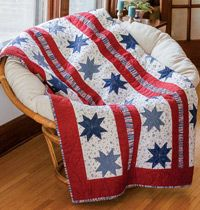 Star-Spangled Beauty - Easy Patriotic Quilt of Valor by Debra Finan. Machine quilted by Kelly Van Vliet. Patriotic stars and stripes are combined into a generously sized Quilt of Valor