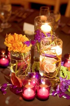 Small candles with the flowers. wedding centerpiece?