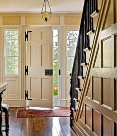 Love the hinges on the door and that wonderful wainscoting on the wall...and the wrought iron railing. LOVE.