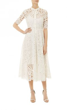 Berry Lace Neck Tie Dress - New Arrivals - Unapologetically feminine, the white Berry Lace Neck Tie Dress, with its graphic lace detailing, is perfect for warmer weather. Fully lined, the A-line silhouette of this front fastening design falls to a flattering mid-length, and features delicate scalloped detailing on the hem and cuffs.