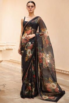 Choose from wide range of designer saree by Sabysachi. Featuring a black saree in organza accented with floral bouquet motifs and embellished border. It comes along with a black sequin embellished blouse. Register now at Carma Online Shop Sabyasachi Sarees, Indian Sarees, Indian Blouse, Indian Wear, Floral Print Sarees, Printed Sarees, Beautiful Saree, Most Beautiful, Sarees For Girls