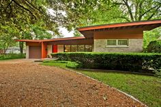 """Designed by Vladimir """"Laddie"""" Novak, noted """"Moderne"""" Chicago Architect, for Donald and Doris Jirka in 1953. The classic 1950's contemporary home features a butterfly roof with a gray brick exterior, stone details, and all Redwood exterior trim."""