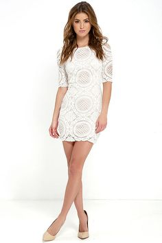 There's no wrong way to wear the Doily Do Right Beige and Ivory Lace Bodycon Dress! Ivory lace overlay tops a beige knit lining, creating a bateau neckline, darted bodice, and sheer half sleeves. Bodycon skirt ends with a sheer hem. Exposed silver back zipper.
