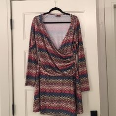 Long Sleeve Print Dress Long sleeve dress. More of a tunic length. Gathers to one side at the waist. This would look great with a tank and skinny jeans Isle Apparel Dresses Midi