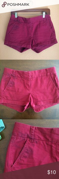 """J. Crew Deep Red Chino Shorts J. Crew 3"""" chino shorts in a deep red color. Unfortunately, I had a shirt bleed on to these shorts as you can see in the picture. It is actually much less noticeable in person because the shorts are so dark, so I think they have lots of life left to them when worn with a longer shirt! I have lots of colors for sale- bundle to save on shipping! J. Crew Shorts"""
