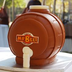 Brides.com: Unique Groom's Cakes. This bride surprised her groom, a budding beer brewer, with a cake resembling the cask from his home-brewing kit. The confection was made of sculpted Rice Krispies Treats (the groom wasn't a fan of cake) that were covered with fondant and airbrushed with edible paint for a smooth finish.  Cake design by Pink Outside the Box Cakes