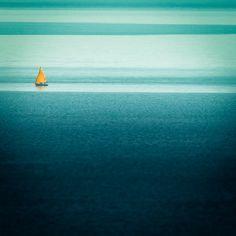 yellow sail, blue sea