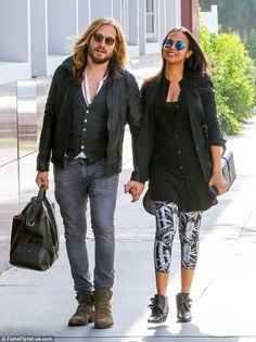 Break: Zoe Saldana and her husband Marco Perego take a little time out from being parents to twins to stroll hand in hand in Santa Monica on Tuesday