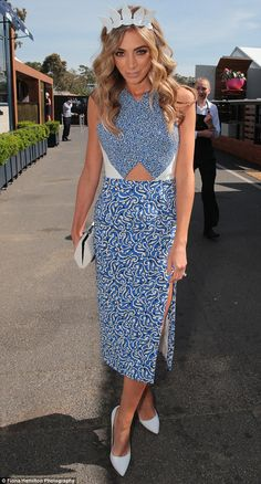 Dare to bare: Nadia Bartel broke a dress code rule by showing off her midriff during Oaks Day at Flemington in Melbourne on Thursday