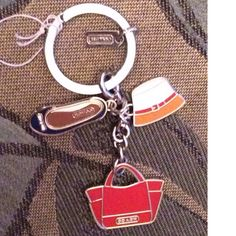 Hat.  Check.  Shoes.  Check.  Purse.  Check.  Hey!  You're ready to go!  Just add the car keys!  Darling keychain, from Coach.  NWT.