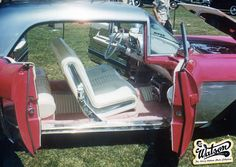Another great snapshot of Larry's personal 1957 Cadillac Brougham.  This time it shows us a good view of the really nicely done interior done by Eddie Martinez in white pearl leatherette and pink fur carpeting. We also get a good look at the chrome plated door panels. Larry had a lot of parts chrome plated on this car. This photo is showing the car in the later version with the silver inset panel decorated with the horizontal chrome tape.