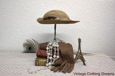 Vintage 70s Hat Brown Tilt Hat Doeskin Brand 1970s Wool Light Tan Felt with Ribbon Feathers 3-51 by VintageClothingDream on Etsy https://www.etsy.com/listing/113542828/vintage-70s-hat-brown-tilt-hat-doeskin