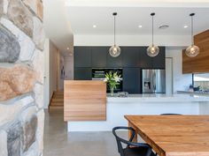 Sleek & Inspiring Luxury Kitchen Design Ideas Photos Browse through our incredible collection of luxury kitchen designs ideas and pictures.Browse through our incredible collection of luxury kitchen designs ideas and pictures. Timber Kitchen, Kitchen Benches, Farmhouse Style Kitchen, Modern Farmhouse Kitchens, Home Decor Kitchen, Kitchen Interior, Kitchen Ideas, Kitchen Modern, Kitchen Black