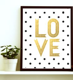If you are planning a gold nursery decor for your little prince or princess- you have got to get one of these Love prints. Get one & shine the