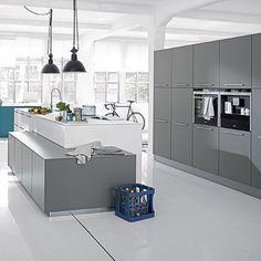 Kitchens: Open Floor Plan Kitchen with Gray Kitchen Cabinet also Sleek Black Microwave plus Black Industrial Pendant Light and Sleek White Flooring