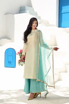 off white suit, pastel blue pants, gold print pants, pastel blue net dupatta