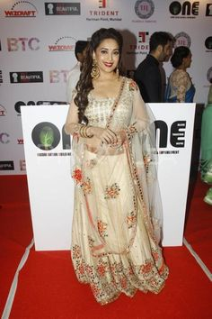 Madhuri Dixit at 'Set Beautiful Free' Event : Though this floral beige lehenga is pretty, the whole getup with that sheer chunni, bold red lips, big earrings and properly styled hair, she seems to have come right from a Bollywood movie set! Indian Wedding Outfits, Wedding Attire, Indian Weddings, Madhuri Dixit Hot, Fashion Shows 2015, Indian Look, Bollywood Saree, Beautiful Bollywood Actress, India Fashion