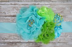Light aqua blue and lime green Maternity Sash for photo prop or baby shower. $28.50, via Etsy.