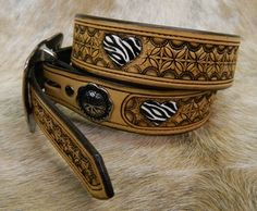 Custom belt with geometric tooling, conchos, and zebra painted hearts by 33 Ranch & Saddlery Leather Tool Belt, Custom Leather Belts, Leather Tooling, Custom Belts, Zebra Painting, Little Cowboy, Leather Carving, Ranch Style, Cuff Bracelets