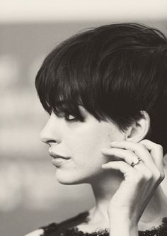 Anne Hathaway. Pixie with thick fringe. Love how classy it looks. :)