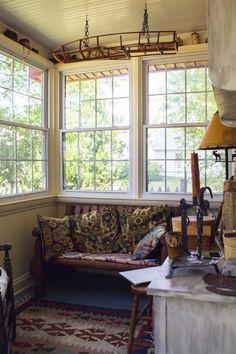sun porch multi paned windows kilim rugs and pillows Micah Rich Sneak Peak DesignSponge