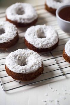 Gluten Free Carrot Cake Baked Donuts - Made in one bowl, healthy and Paleo friendly! Coconut cream frosting add the perfect, Easter touch! | Foodfaithfitness.com | @FoodFaithFit