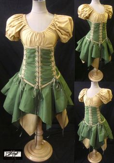 SASSY WOOD ELF  Puff sleeve top, 4-Tie Under-Bust Corset, Olive and Antique Tan Jagged Skirts. $234.99, via Etsy.