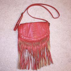 Leather Fringe Purse Bought from target. Used. Reddish orange leather. Adjustable strap Mossimo Supply Co Bags