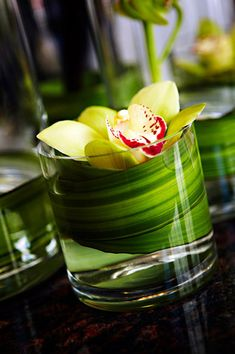 """Extra arrangements to put around the reception: bar/buffet/sign in, etc. starting with 10, maybe more based on cost. Like this look exactly. We have 3"""" x 3"""" cylindrical vases"""