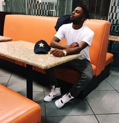 Isaiah Rashad in the Nike Air Command Force Emerald