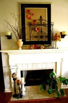 Fireplace mantle decor.  Probably not the décor I would use, but I love the layout.