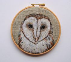 A 5 inch embroidery hoop featuring a sweet embroidered barn owl, stitched onto recycled fabric. A striking embroidery ready to hang on your wall.  The barn owl was created from layers of free machine embroidery and is really like a little painting in thread. I wanted to make the owl as realistic as possible and enjoyed using my sewing machine as a paint brush, layering threads and stitches to get his colours, markings and texture of his feathers just right. I finished off his eyes and beak…