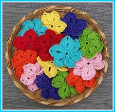 Crocheted flowers...I will be making some of these today...