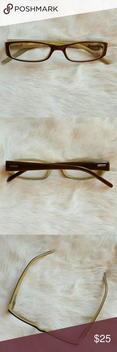 DKNY Cream and Tan Frames Dark taupe outer frames, and creamy colored inner frames. Narrower frame around around eyes, size 49-16. These do have a prescription in them, will need to have your own filled in. DKNY Accessories Glasses